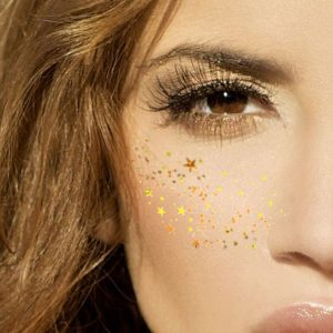 woman's face with metallic faux freckles