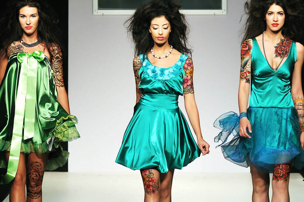 model on runway wearing temporary tattoos for adults